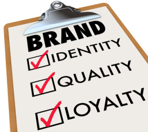 Brand Checklist Identity Quality Loyalty on Clipboard